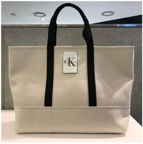 Calvin Klein CARRYALL MEDIUM CKロゴトートバッグ HH1477C6200